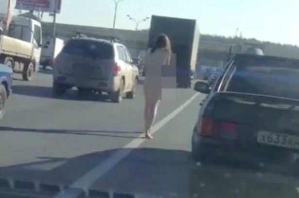 Woman naked in street
